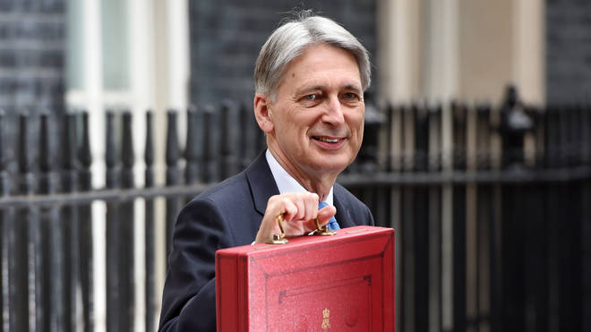 Philip Hammond holds up the Budget Red Box