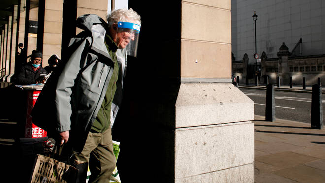 Shielding ends on April 1: Pictured, a man wearing a face shield walks outside Westminster Station in London