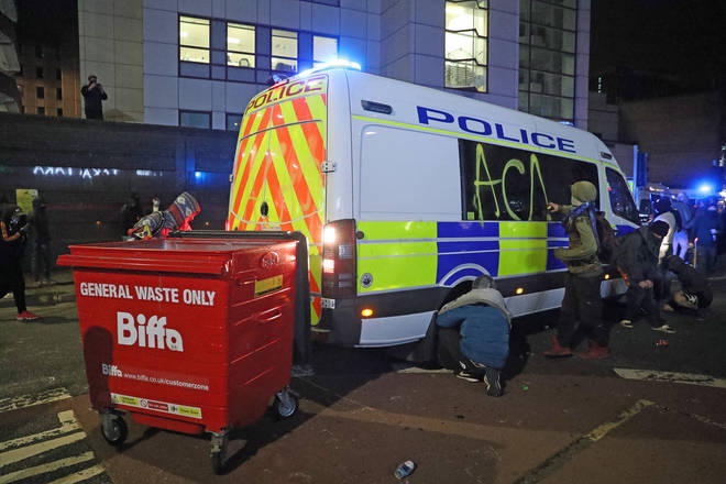 Pictures showed graffiti being sprayed on an Avon and Somerset Police vehicle