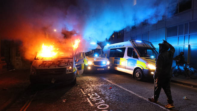 Police vans have been set on fire at the protests