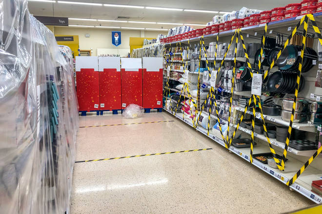 Aisles selling non-essential goods in Welsh supermarkets have been taped off for months