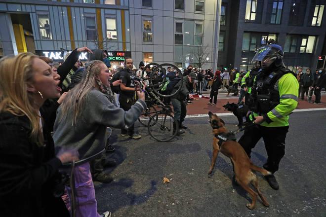 Protester confront police in Bristol on Saturday evening