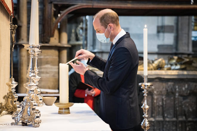 Prince William lights a candle at Westminster Abbey