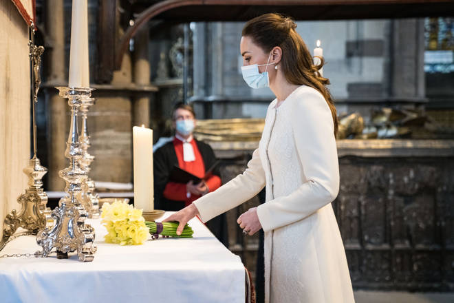 The Duchess of Cambridge lights a candle at Westminster Abbey