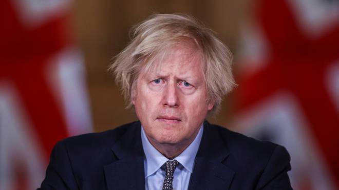 Boris Johnson hailed the UK's courage through a year of lockdowns