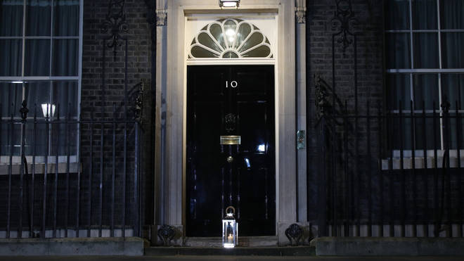 "A candle was placed outside 10 Downing Street to signify a ""beacon of remembrance"" in London"