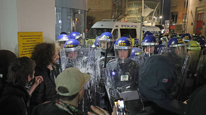 Police officers and protesters in Bristol on Saturday evening