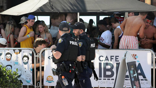 Authorities have struggled to manage huge gatherings of people at bars and beaches during the US spring break