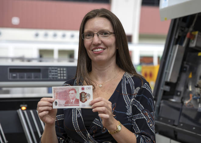 Sarah John, Chief Cashier at the Bank of England, holding the new £50 note featuring scientist Alan Turing