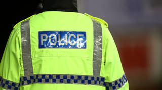 A conwoman dressed in a fake police uniform stole £12,000 cash from the pensioner