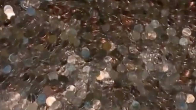 The pennies were left at the bottom of the man's driveway