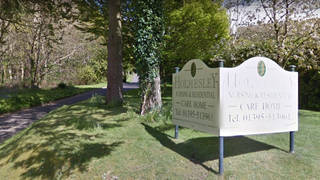 Police have arrested two members of staff at a South Devon care home