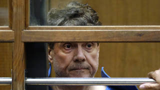 Dr. George Tyndall listens during his arraignment at Los Angeles Superior court