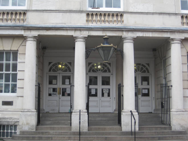 Verphy Kudi stood in the dock at Lewes Crown Court on Friday morning