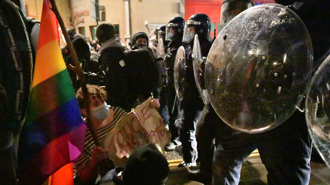 Protesters face off against police in riot gear in Bristol