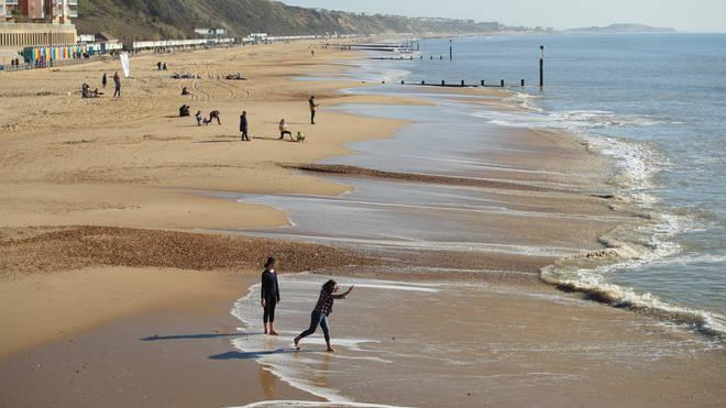 People enjoy the weather at Sandbanks beach, Dorset
