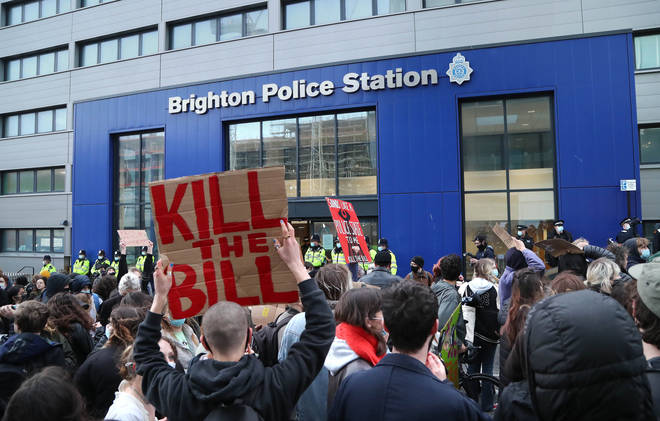 Demonstrators outside Brighton Police Station during a Kill The Bill protest