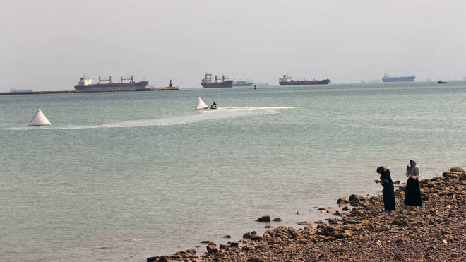 As of early Sunday, more than 320 ships were waiting to travel through the waterway, either to the Mediterranean or the Red Sea