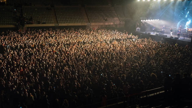 Fans at the concert by rock group Love of Lesbian