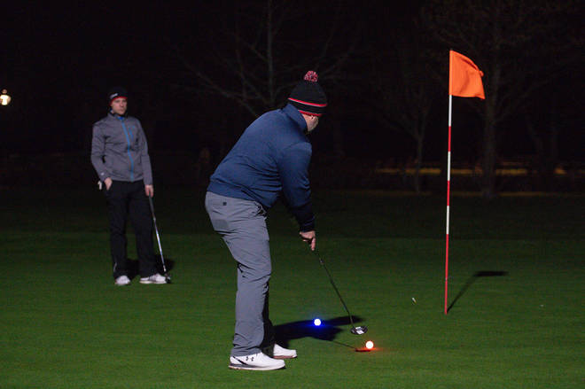 The golfers used glow-in-the-dark balls and floodlit greens