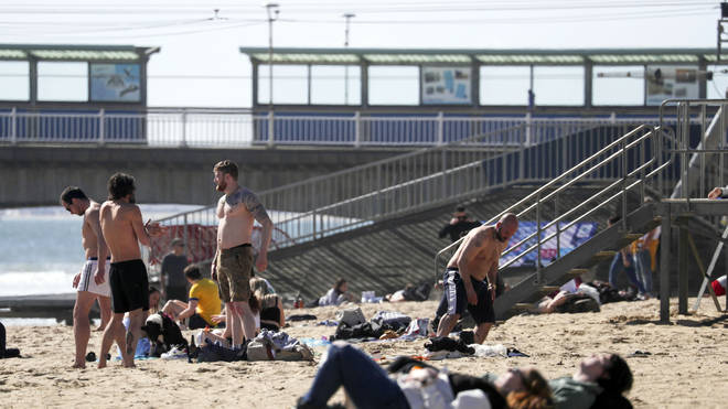 Sun-seekers gather on Bournemouth beach as lockdown eased today.