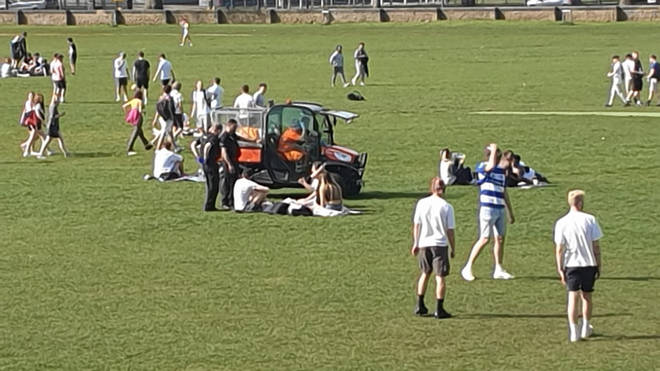 Police confiscating alcohol from people in the Forest Recreation Ground, Nottingham