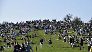 Hundreds gathered at Primrose Hill as a mini heatwave swept the UK