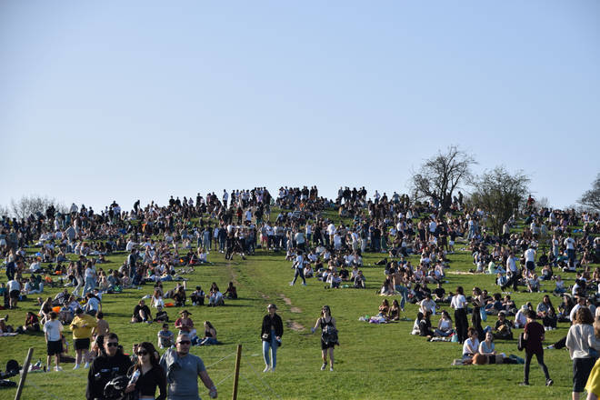 """Police were called to reports of a """"man armed with knife behaving erratically"""" as hundreds gathered at Primrose Hill on Tuesday evening."""