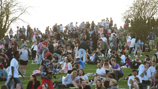 Crowds of people gathered on Primrose Hill in London to enjoy the mini-heatwave on Tuesday, with more high temperatures forecast.
