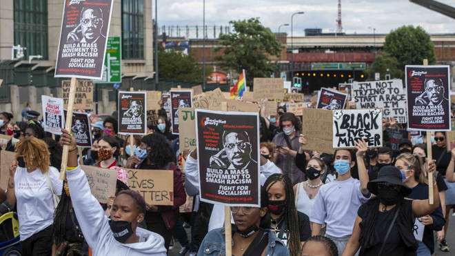 People during a protest march organised by Black Lives Matter from the US Embassy towards Parliament square