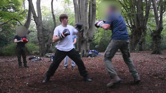 A clip shows Hannam participating in outdoor boxing event.