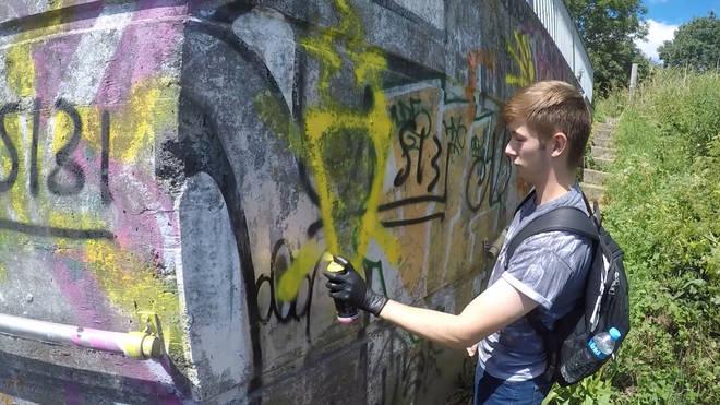 Hannam was seen daubing graffiti in scenes shown to the jury.