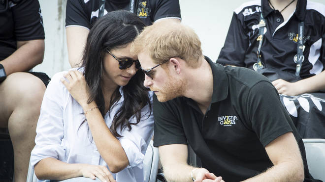 Prince Harry and Meghan Markle talk during the Invictus Games
