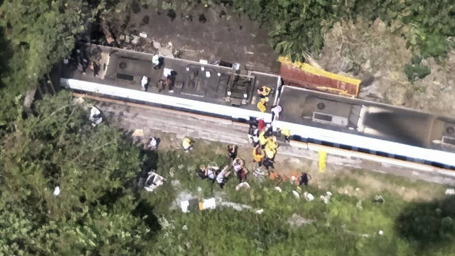 Firefighters are working to free any of the trapped passengers