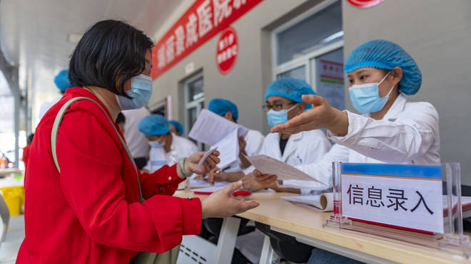 State broadcaster CCTV showed people lining up and getting vaccinated in Ruili, where 16 cases have been confirmed since Tuesday