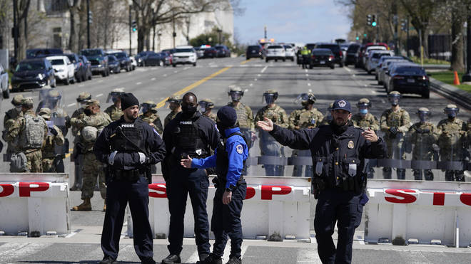 Members of the U.S. Capitol Police stand guard near the scene
