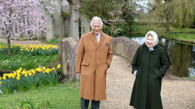 The Queen and Prince Charles were pictured smiling while walking in Windsor ahead of Easter