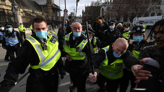 Police push back protesters during a Kill The Bill demonstration outside of the Houses of Parliament.