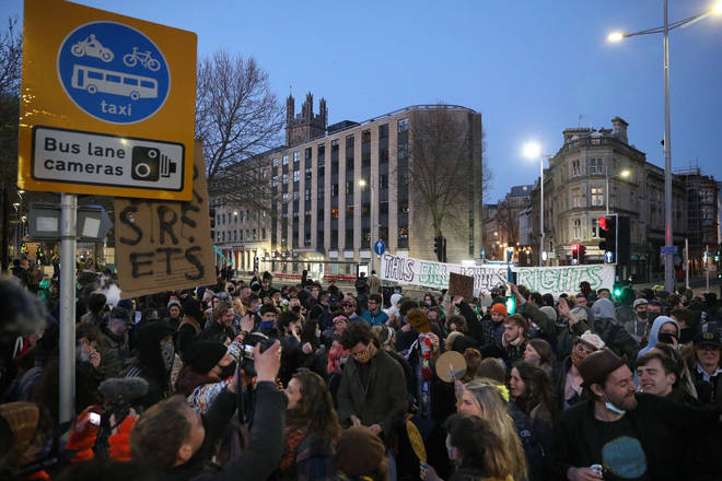 A group of around 500 people gathered in central Bristol with drinks and music before a section split off to block the M32.