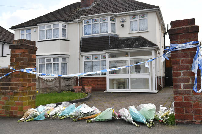 Floral tributes have been left outside Ms Downer's house.