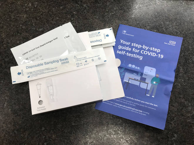 A package of seven NHS Test and Trace Covid-19 self-testing kits, similar to that which will be handed out by pharmacies.