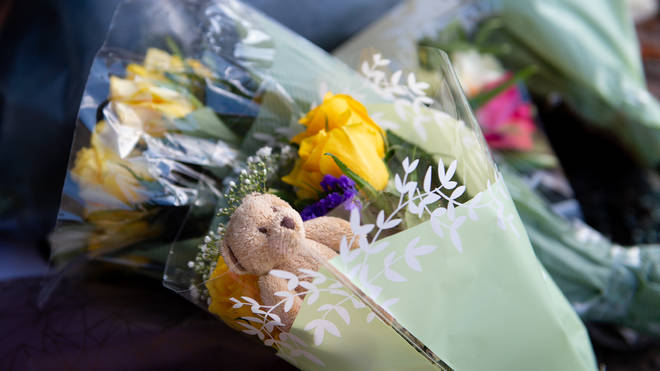 Flowers and soft toys have been laid at the scene of the collision.