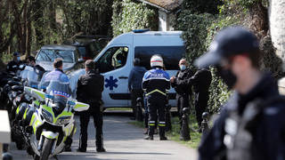 Police stand guard at Bernard Tapie's house in Combs la Ville.