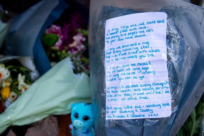Some left emotional messages alongside flowers