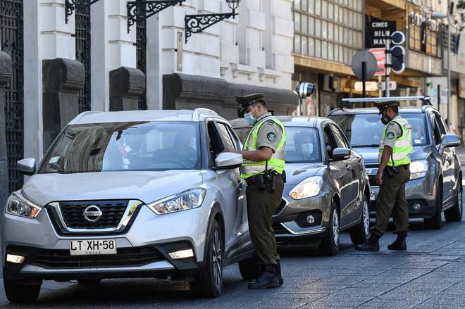 Police check citizens' outdoor permits in Santiago, Chile.