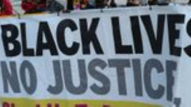 A Black Lives Matter banner (PA)