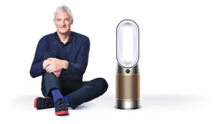 James Dyson with the firm's latest air purifier, which is able to remove the pollutant formaldehyde from the air