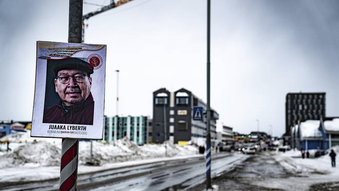 An election candidate's advertising poster for the election in Greenland (Emil Helms/AP)