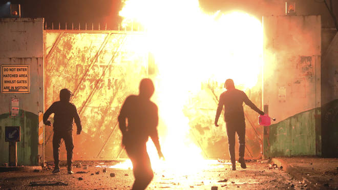 Rioters threw petrol bombs and fireworks at each other on Wednesday night