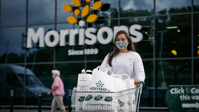 A woman using Morrisons paper bags for her shopping